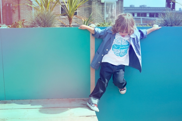 Sonny is wearing 'Brain' t-shirt by Gregori Saavedra and French Chore Coat in Blue