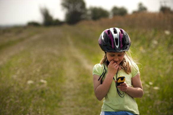 Child with a handheld GPS at Wicken Fen National Nature Reserve, Cambridgeshire.