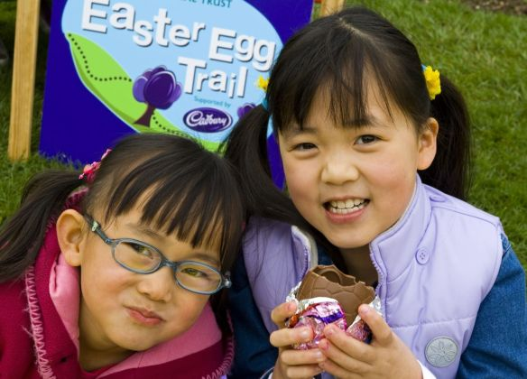 Children enjoying their chocolate eggs after completing the Easter Egg Trail event at Kedleston Hall, Derbyshire